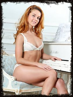 Roberta Berti strips her white lingerie as she bares her sexy tight body and yummy assets as she poses wide open on the chair.