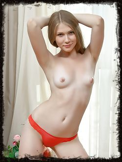 Smooth and pale-skinned Kessie flaunts her pink puffy breasts and shaven pussy.
