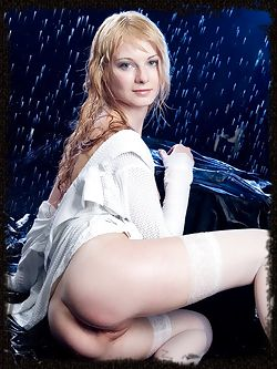 Splashy girl who strips on the stage as the water dances on her nude body.