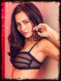 A sizzling hot Michaela Isizzu posing in her black mesh lingerie that highlights her tight body before enjoying a refreshing shower.