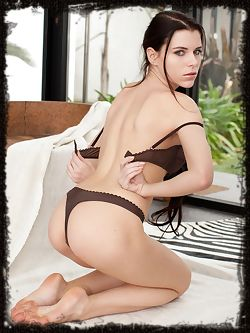 Adorned in sexy black lingerie lying on a zebra rug Valeria A is a playful little minx