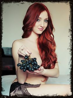 Enticing redhead with seductive, bedroom eyes and youthful allure.