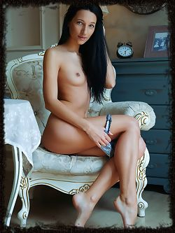 Kenya strips on the chair baring her sexy body.