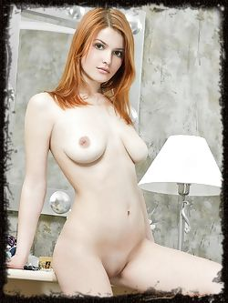 Violla A's womanlly allure stands out, with her pale smooth skin, fiery red hair and smooth, pink pussy.